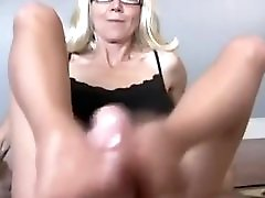Sexi Milf In Glasses Like Footjob