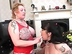 Pierced And Tattooed Milfs Taking On Two Cocks