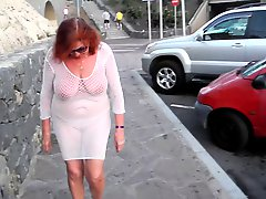 Beautiful Mature Slut Walks Around The City With Naked Boobs