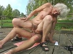 Granny Norma Fucks And Sucks Outdoors