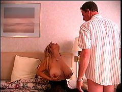 Long Haired D Cup Blonde Sucks Business Dude's Cock Then Fucks Him With Strap On