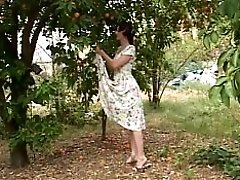 Mature Milf Takes Younger Slut's Top Off And Sucks Her Tits Outside